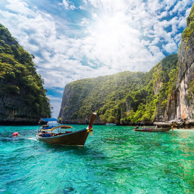 traditional boat on the sea in Phi Phi Lee region of Losama Bay, Thailand
